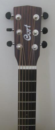 Headstock of the Cort Earth-Mini guitar