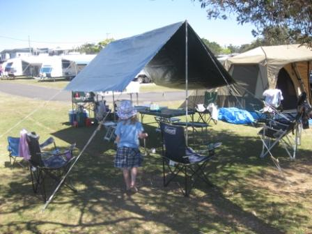 Simple 10' x 12' tarpaulin setup covering two tables