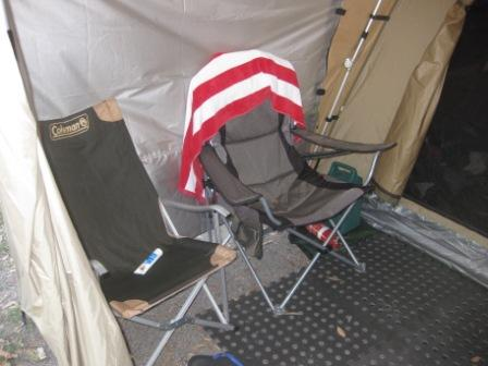 Two chairs under the BlackWolf Turbo Plus 240 awning