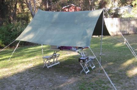 Simple 8' x 10' tarp setup covering one table