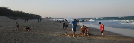 Dicky Beach at sunset, with the remains of the SS Dicky shipwreck in the background